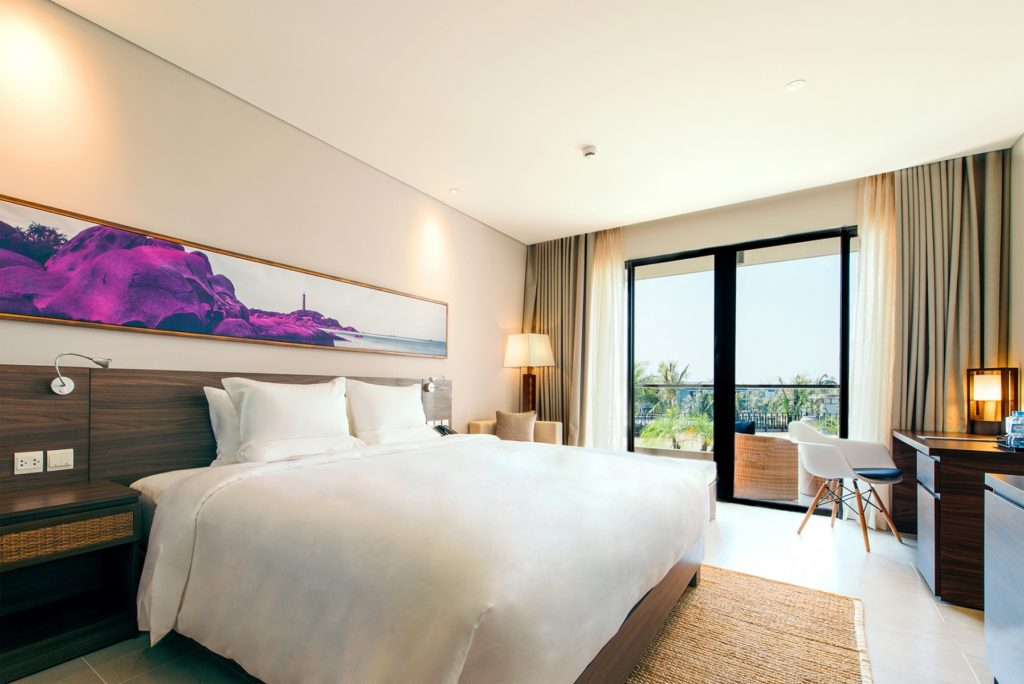 Artwork above the bed in purple at the novotel Phu Quoc